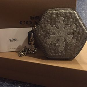 NWT Coach Silver wristlet with Glitter snowflake